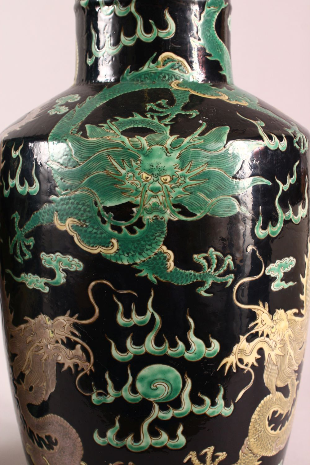 A LARGE PAIR OF CHINESE FAMILLE NOIR PORCELAIN DRAGON VASES, each vase with a black ground depicting - Image 2 of 13