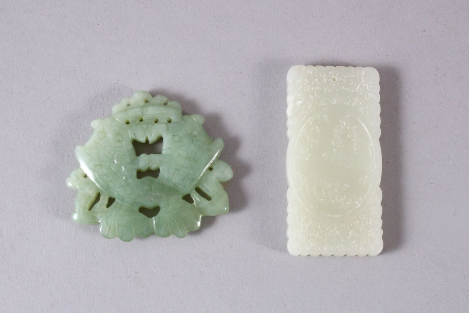 TWO CHINESE CARVED JADE TWIN FISH & IMMORTAL PENDANTS, one carved in the form of twin fish, 5cm,