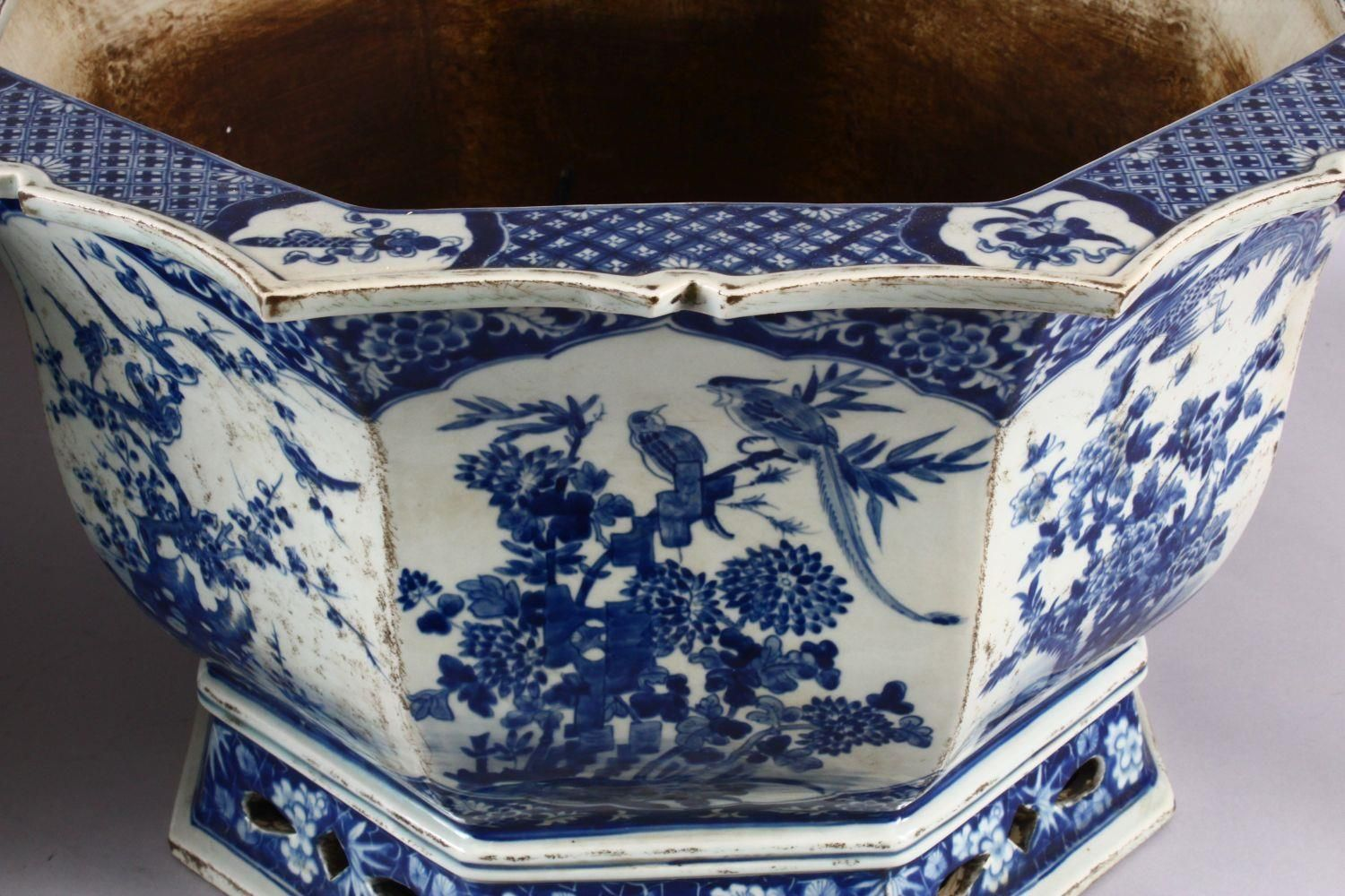 A PAIR OF LARGE CHINESE BLUE & WHITE OCTAGONAL PORCELAIN JARDINIERE / PLANTERS, decorated with - Image 4 of 8