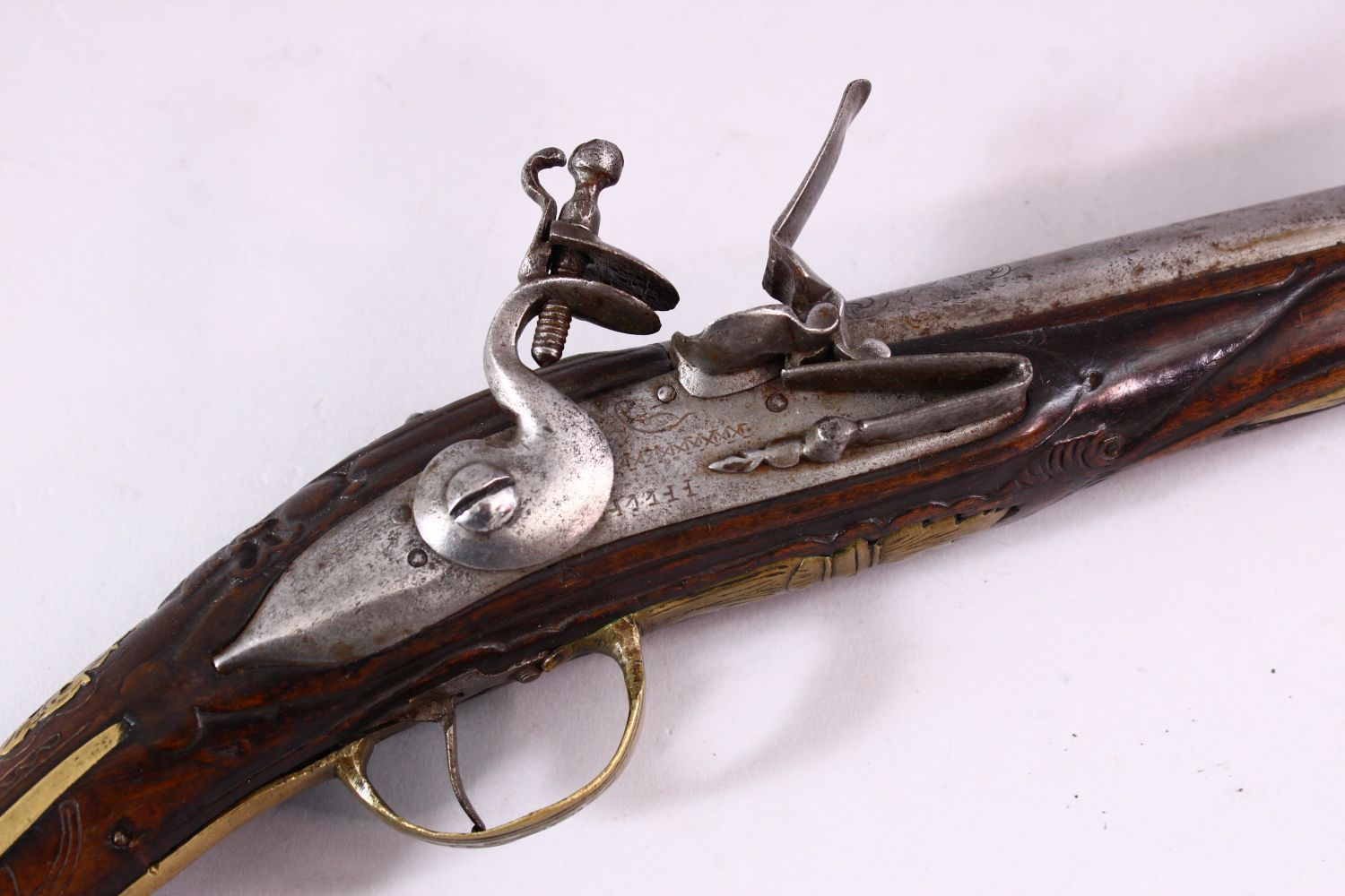 AN 18TH CENTURY ANGLO INDIAN FLINTLOCK PISTOL, engraved barrel, carved stock with wire inlaid - Image 2 of 4