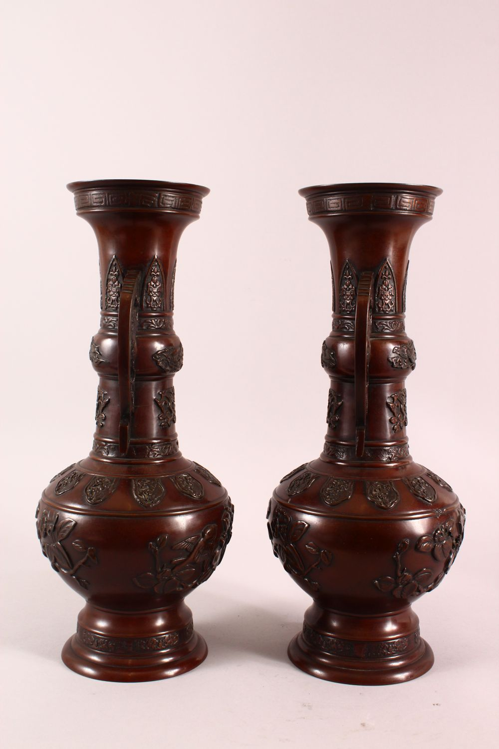 A PAIR OF JAPANESE RELIEF BRONZE VASES, with twin handles, relief birds and flora decoration, 40cm - Image 6 of 7
