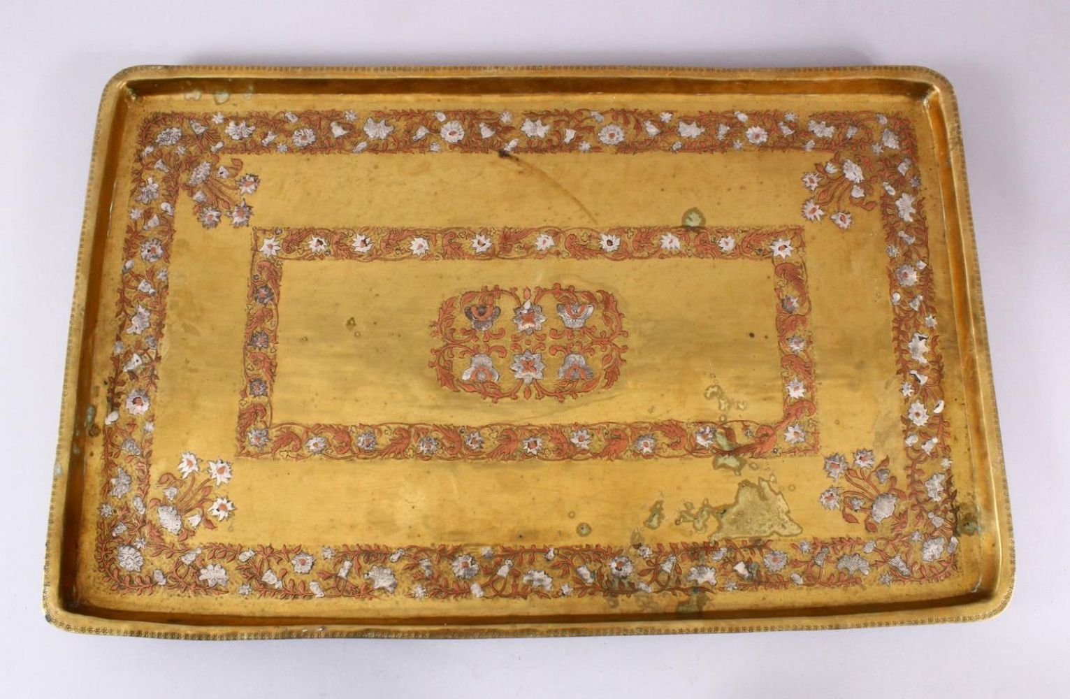 A LARGE EARLY 19TH CENTURY SOUTH INDIAN TANJORE SILVER AND COPPER INLAID RECTANGULAR TRAY, 59cm x