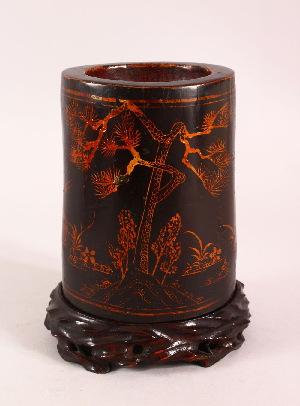 A CHINESE LACQUERED BAMBOO BRUSH WASH AND STAND, the body decorated with birds in landscapes, 19cm
