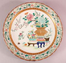 A JAPANESE PORCELAIN CHARGER, decorated with displays of ikebana, the verso with underglaze blue