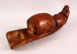 A 20TH CENTURY CHINESE BAMBOO CARVING of a figure on a raft with barrel, 48cm long.