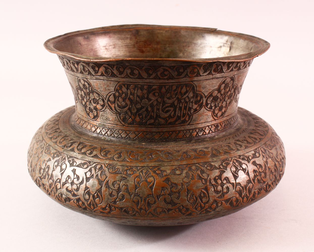 A 17TH CENTURY PERSIAN CALLIGRAPHIC BOWL -SIGNED - the body with carved floral motif decoration, the