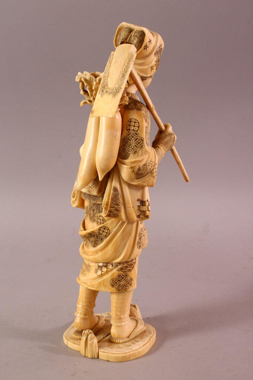 A LARGE JAPANESE MEIJI PERIOD CARVED IVORY OKIMONO - FARMER - the large okimono depicting a female - Image 5 of 11