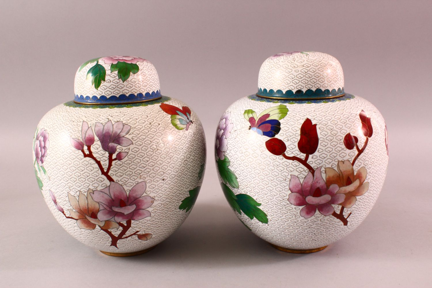 A PAIR OF CHINESE CLOISONNE GINGER JARS & COVERS, each with a white ground and floral decoration, - Image 3 of 7