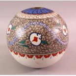 AN IZNIK TURKISH POTTERY HANGING BALL FOR MOSQUE, decorated with a white glaze with motif