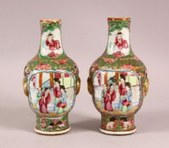 A PAIR OF 19TH CENTURY CHINESE CANTON FAMILLE ROSE PORCELAIN VASES, with panelled figural decoration