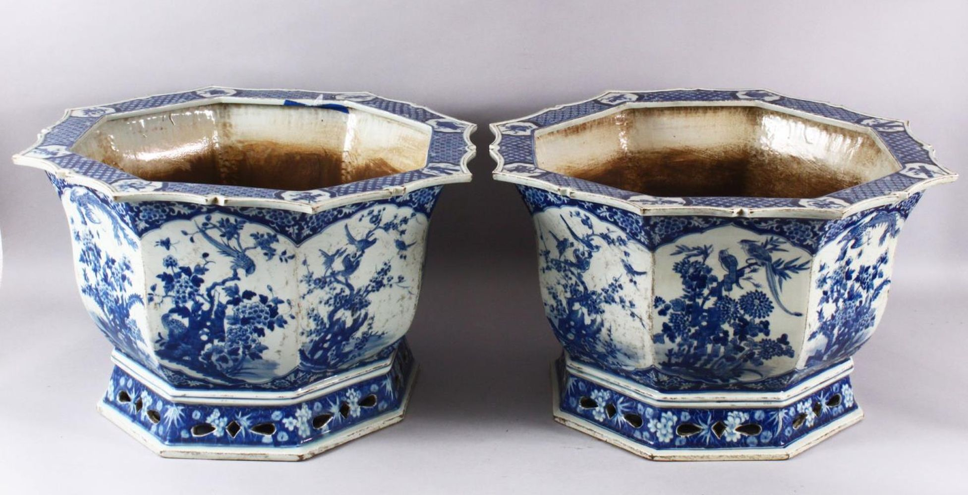 A PAIR OF LARGE CHINESE BLUE & WHITE OCTAGONAL PORCELAIN JARDINIERE / PLANTERS, decorated with