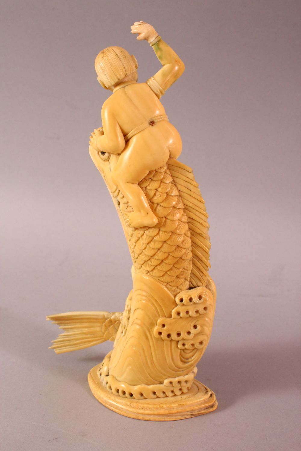 A JAPANESE MEIJI PERIOD CARVED IVORY FISH OKIMONO, the fish emerging from the water with a boy on - Image 4 of 9