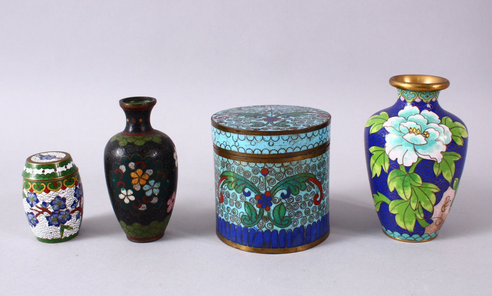 A MIXED LOT OF FOUR CHINESE CLOISONNE VASES / BOX - consisting of a cylindrical lidded blue ground