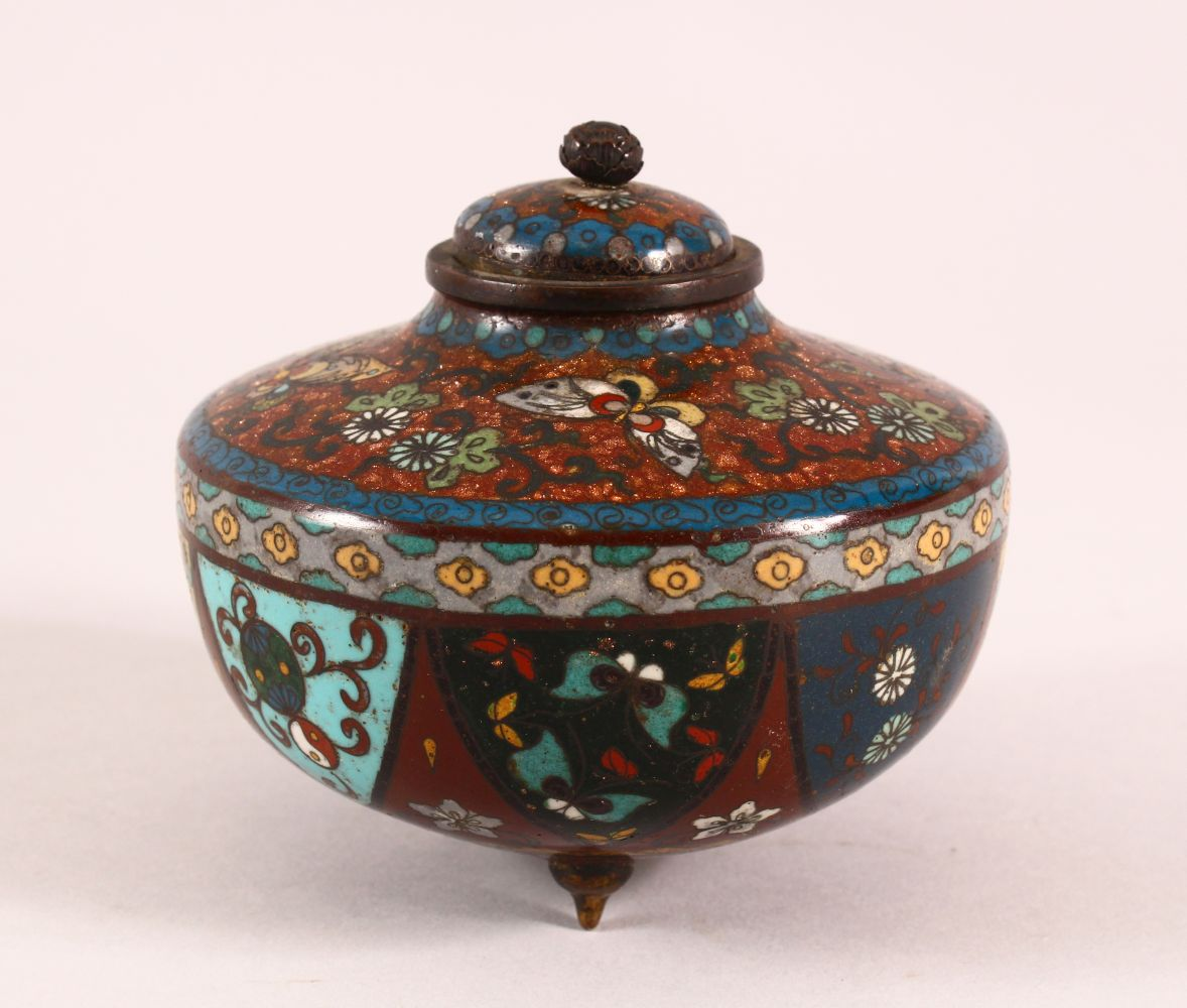 A CLOISONNE KORO AND COVER, decorated with butterflies, flowers and buddhistic emblems, on three