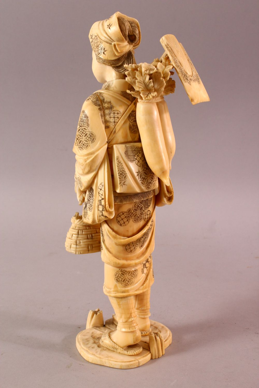 A LARGE JAPANESE MEIJI PERIOD CARVED IVORY OKIMONO - FARMER - the large okimono depicting a female - Image 6 of 11