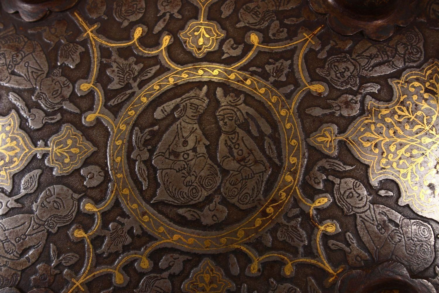 A LARGE 19TH CENTURY PERSIAN GILT DECORATED STEEL SHIELD, with carved decoration of figures, bands - Image 3 of 12