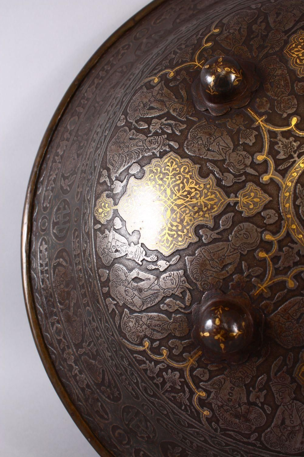 A LARGE 19TH CENTURY PERSIAN GILT DECORATED STEEL SHIELD, with carved decoration of figures, bands - Image 4 of 12