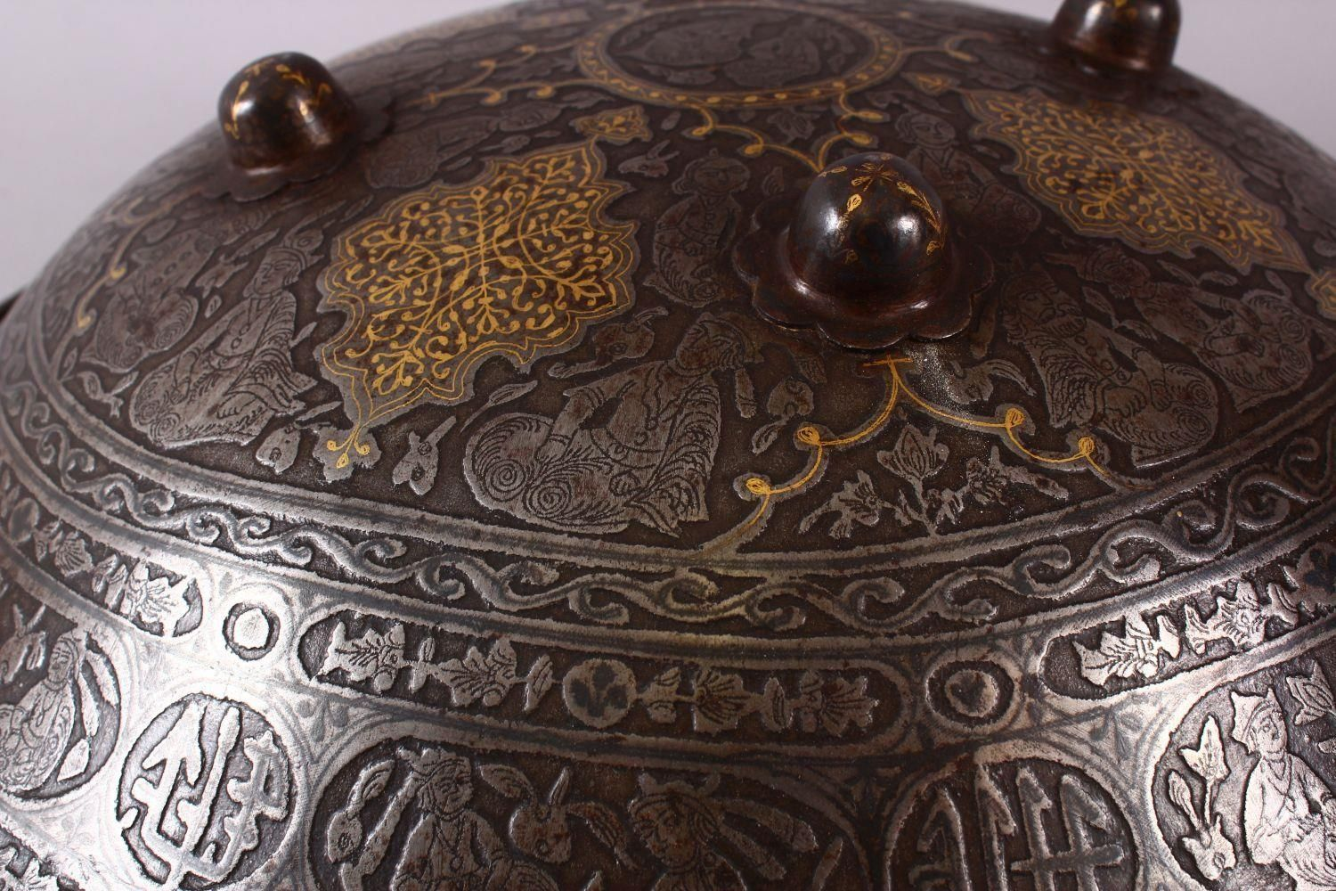 A LARGE 19TH CENTURY PERSIAN GILT DECORATED STEEL SHIELD, with carved decoration of figures, bands - Image 7 of 12