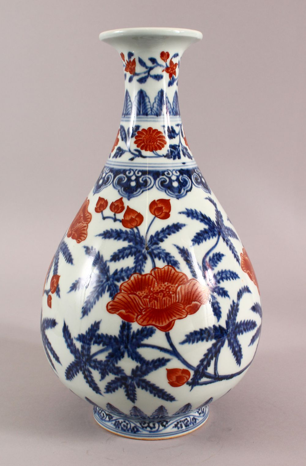 A CHINSE UNDEGLAZED BLUE & COPPER RED LOTUS PORCELAIN VASE, the base with a six character mark, 34cm