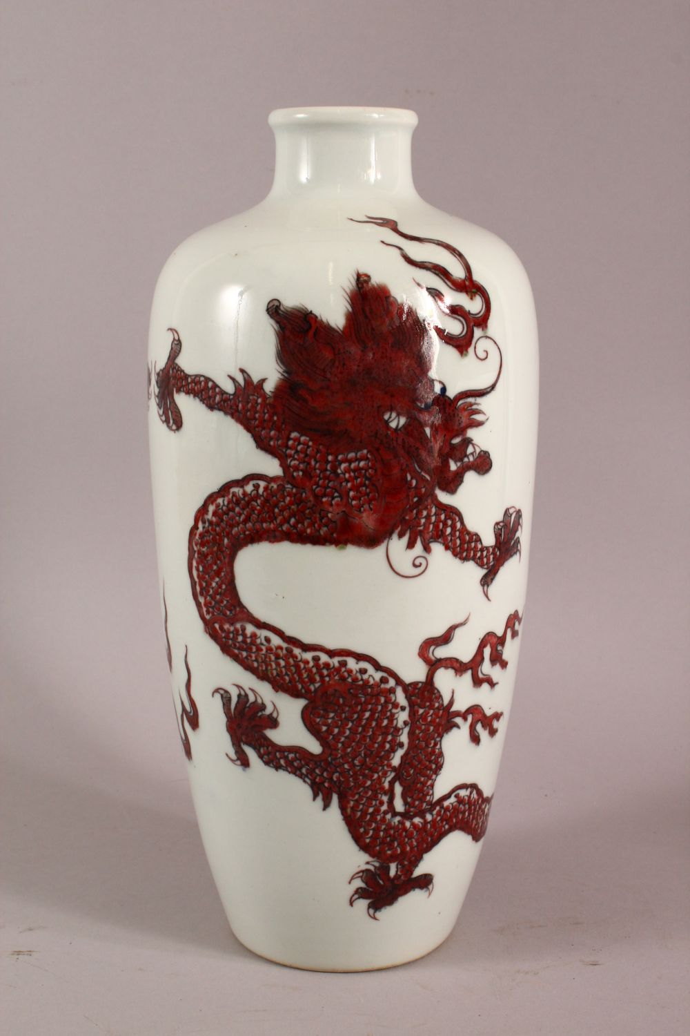 A CHINESE COPPER RED GLAZED PORCELAIN DRAGON VASE, with double blue rings to base, 32cm - Image 3 of 5