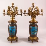 A VERY GOOD PAIR OF JAPANESE CLOISONNE AND ORMOLU NINE LIGHT CANDELABRA, the candle branches