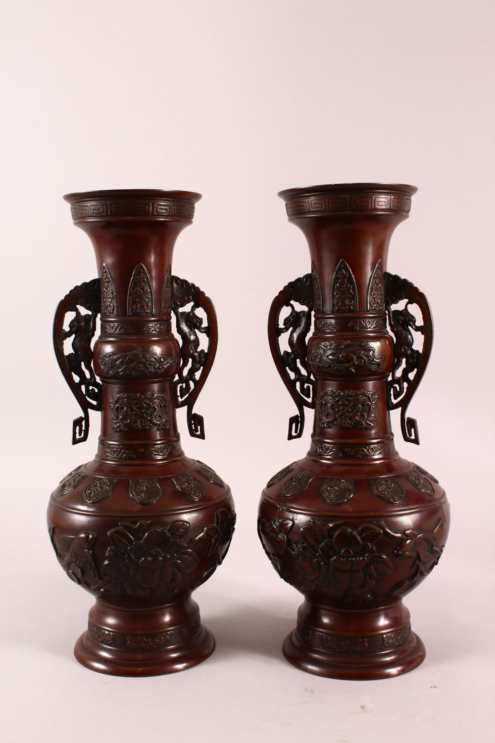 A PAIR OF JAPANESE RELIEF BRONZE VASES, with twin handles, relief birds and flora decoration, 40cm - Image 5 of 7