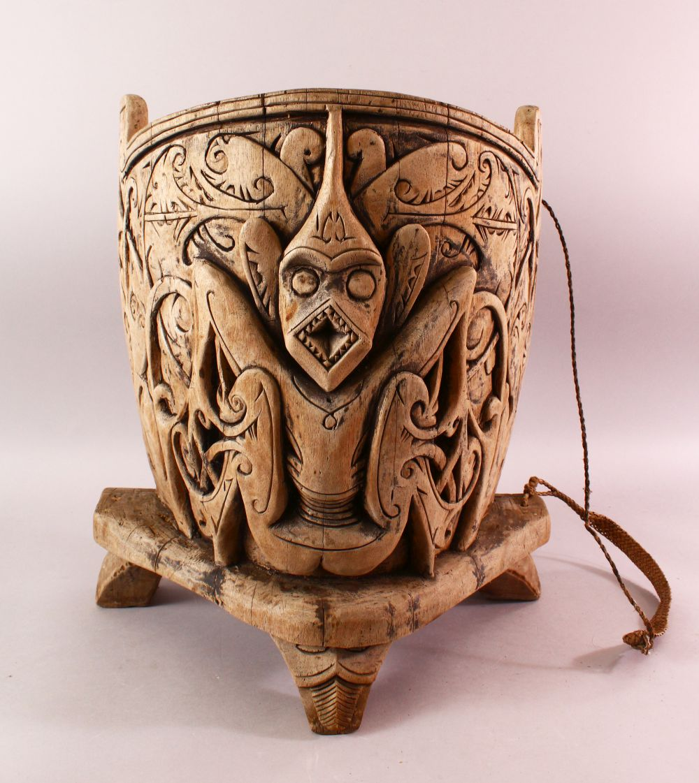 A 19TH / 20TH CENTURY INDIAN CARVED WOODEN BABY CARRIER, Carved with mythical beasts and foliage,
