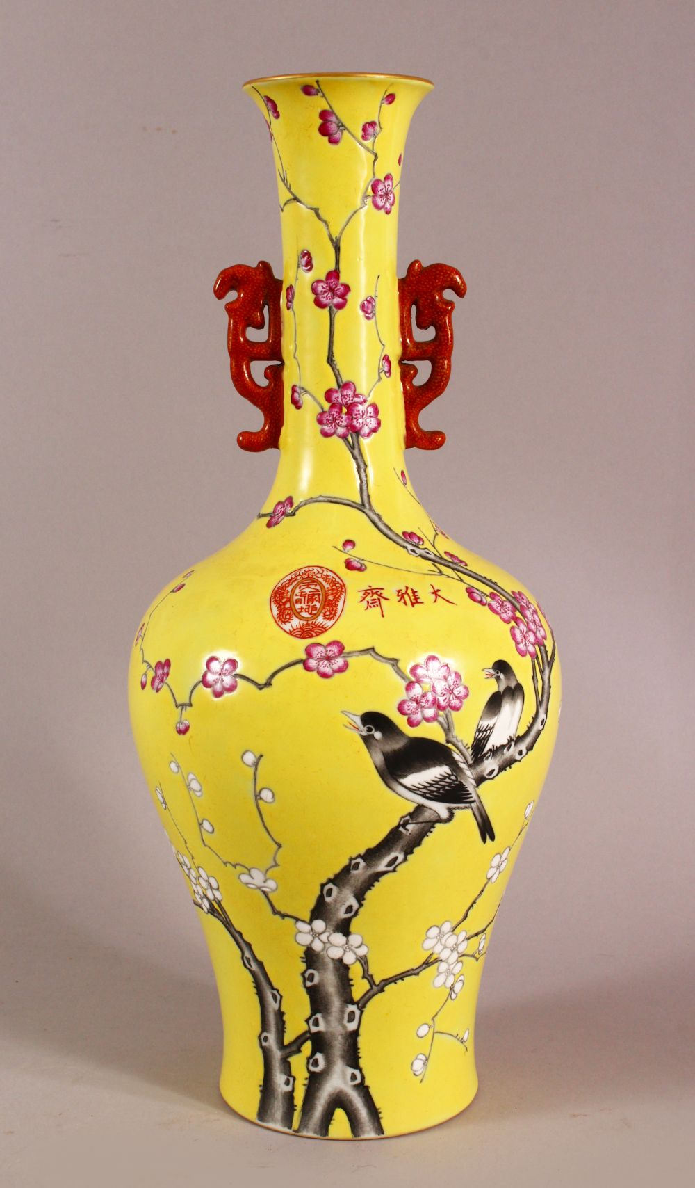 A CHINESE YELLOW GLAZED FAMILLE ROSE PORCELAIN VASE, decorated with birds in trees, with a mark