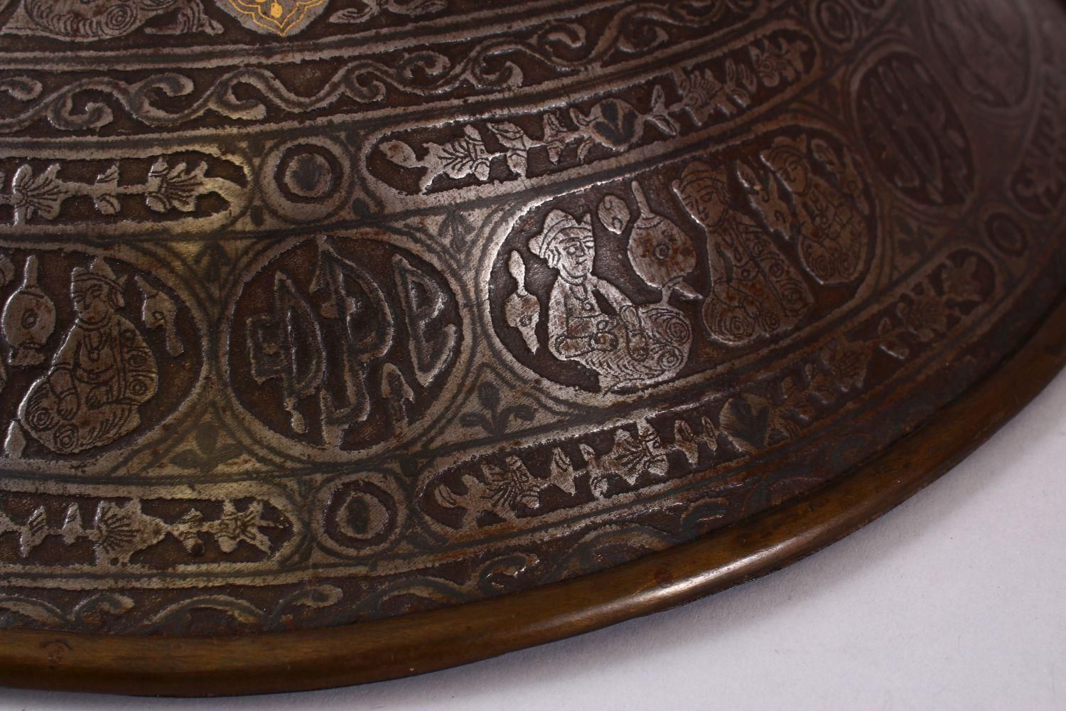 A LARGE 19TH CENTURY PERSIAN GILT DECORATED STEEL SHIELD, with carved decoration of figures, bands - Image 9 of 12