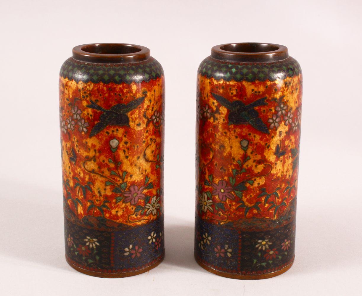A PAIR OF JAPANESE CLOISONNE VASES OF CYLINDRICAL FORM, gold ground, 15cm high.
