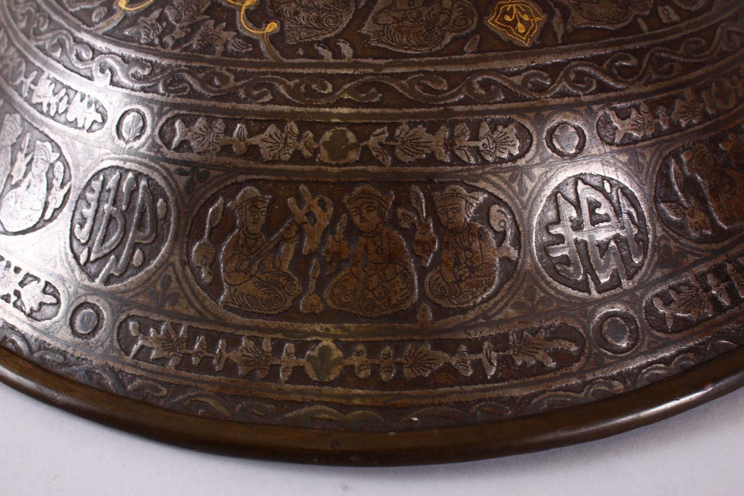 A LARGE 19TH CENTURY PERSIAN GILT DECORATED STEEL SHIELD, with carved decoration of figures, bands - Image 10 of 12