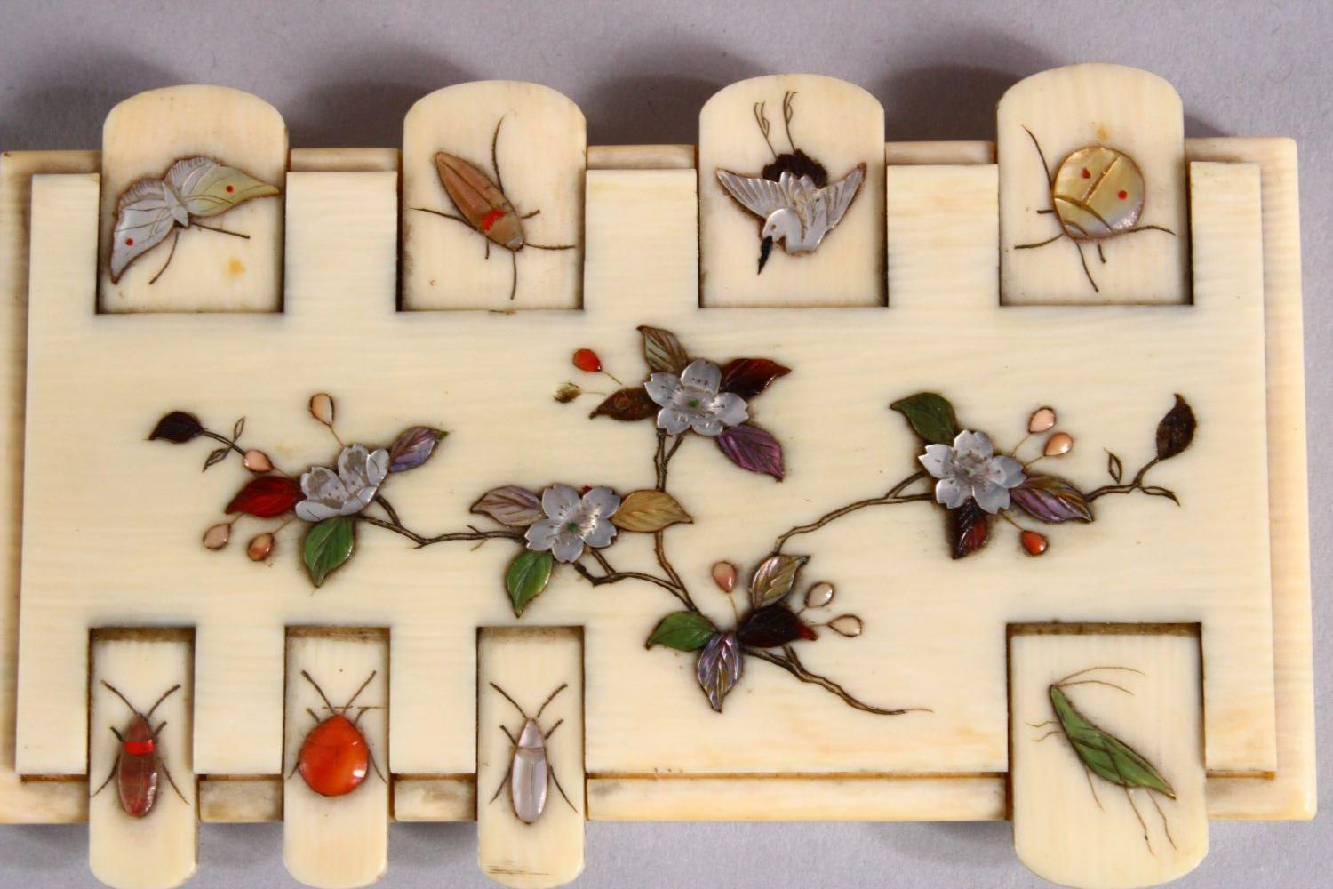 A PAIR OF JAPANESE MEIJI PERIOD SHIBAYAMA IVORY GAMES COUNTERS, each inlaid with semi precious - Image 3 of 4