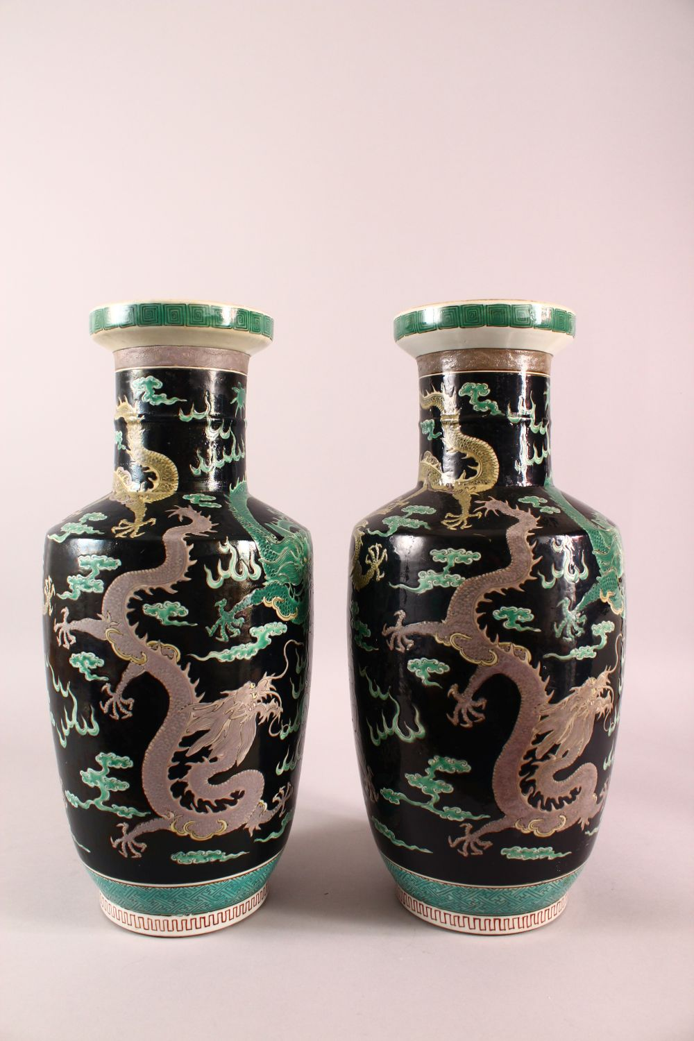 A LARGE PAIR OF CHINESE FAMILLE NOIR PORCELAIN DRAGON VASES, each vase with a black ground depicting - Image 4 of 13