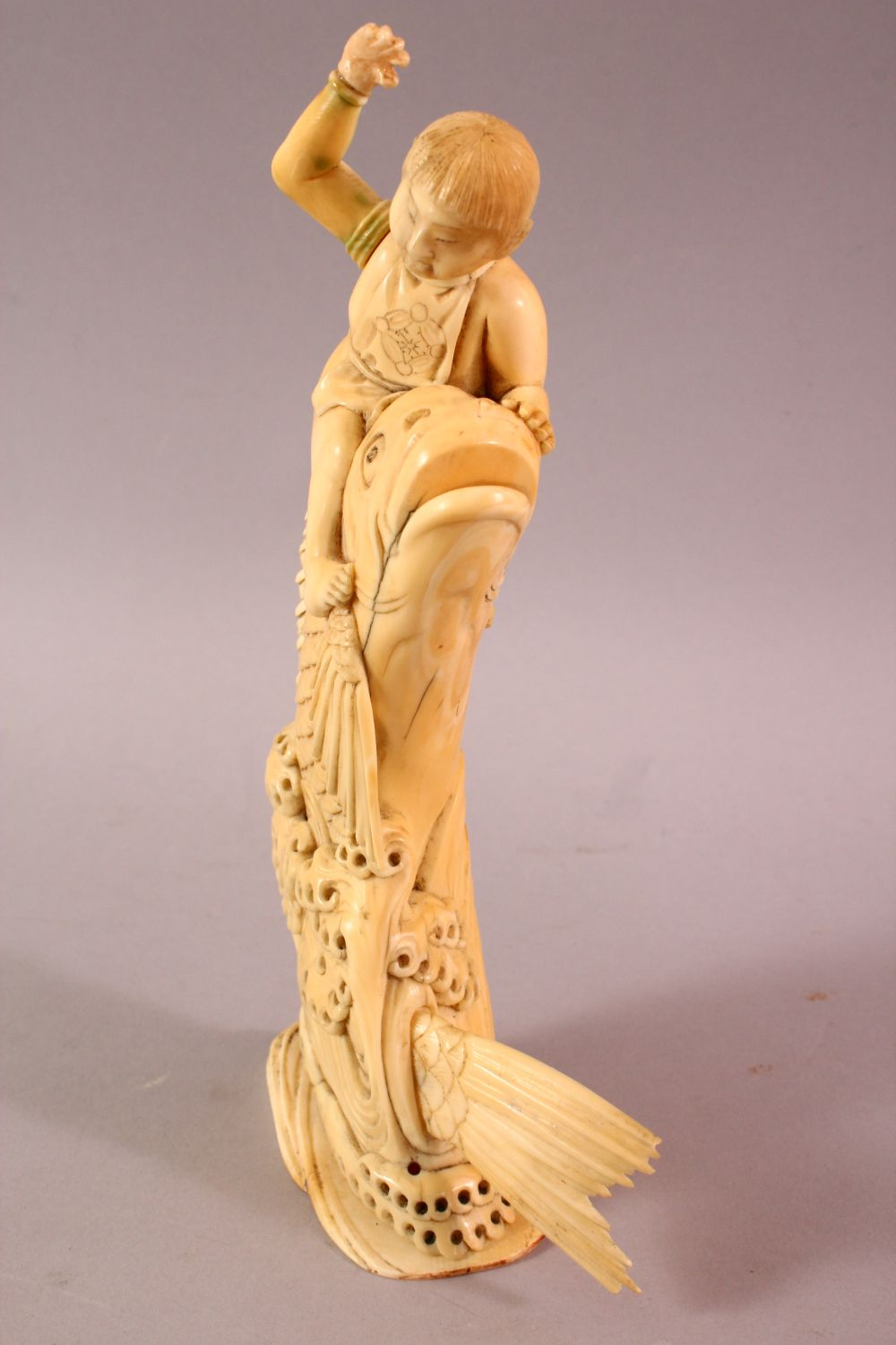 A JAPANESE MEIJI PERIOD CARVED IVORY FISH OKIMONO, the fish emerging from the water with a boy on - Image 5 of 9