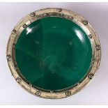AN EARLY EASTERN GREEN GLAZED & WHITE METAL LARGE POTTERY DISH, the large dish glazed with a green