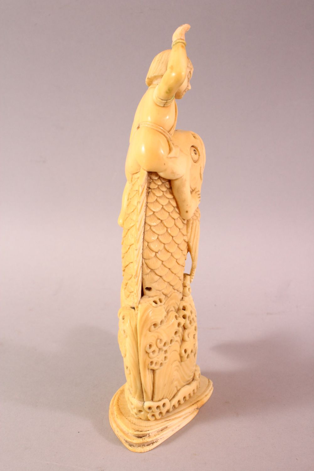 A JAPANESE MEIJI PERIOD CARVED IVORY FISH OKIMONO, the fish emerging from the water with a boy on - Image 3 of 9