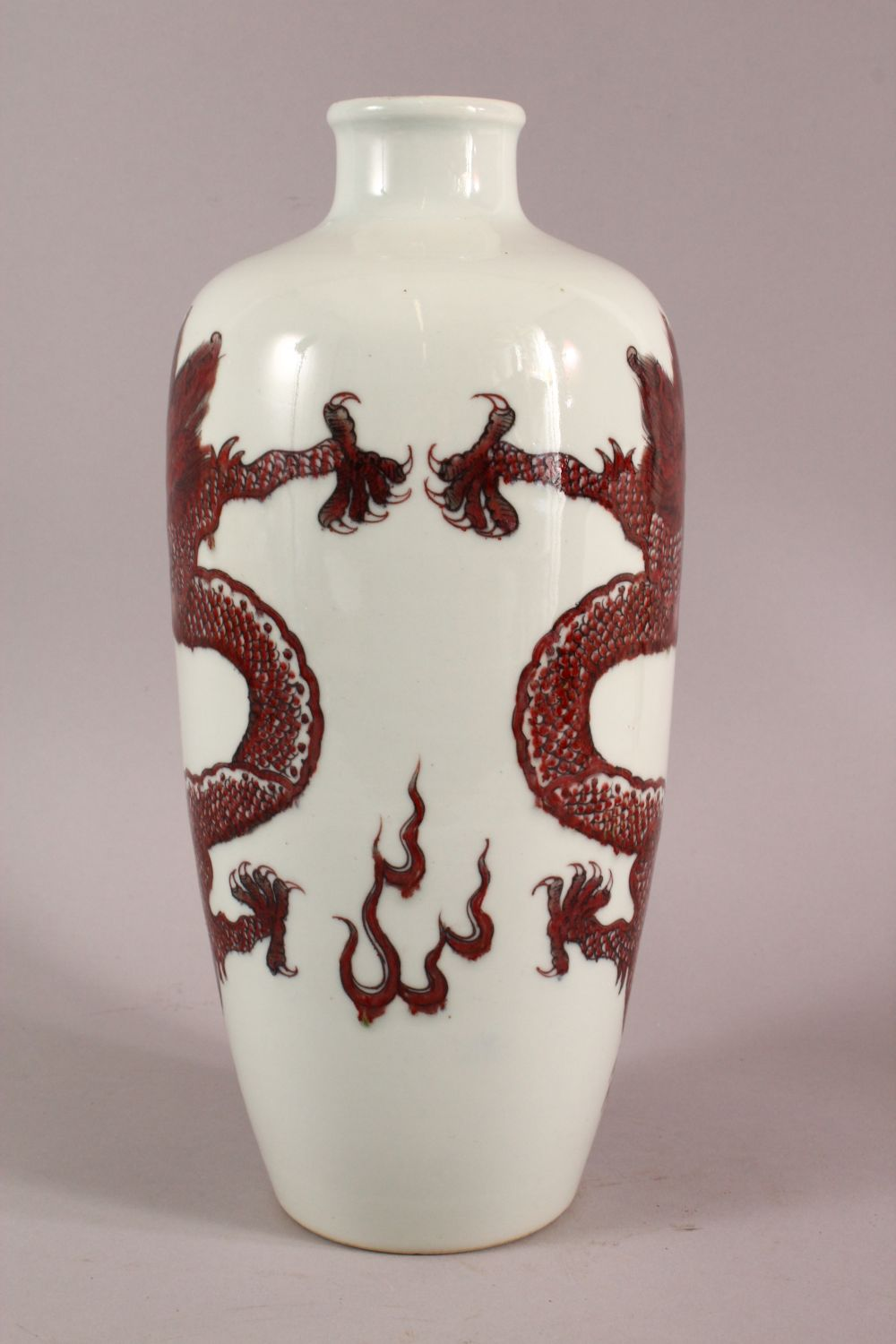 A CHINESE COPPER RED GLAZED PORCELAIN DRAGON VASE, with double blue rings to base, 32cm - Image 4 of 5