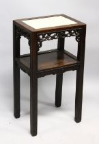 A GOOD LATE 19TH CENTURY CHINESE HARDWOOD TWO TIER STAND, the top inset with a marble panel above