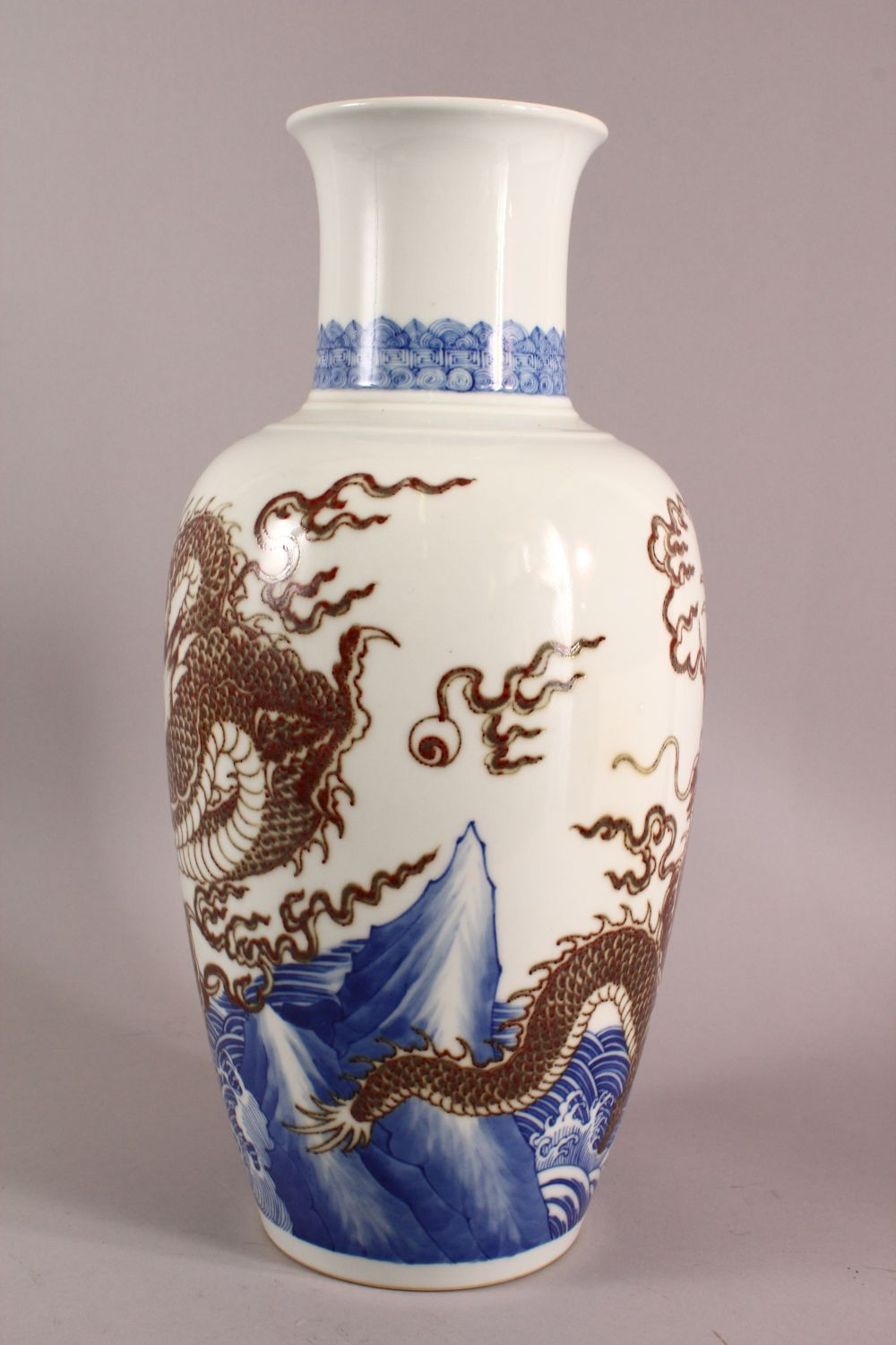 A LARGE CHINESE UNDERGLAZE BLUE & COPPER RED PORCELAIN VASE, decorated with dragons amongst waves, - Image 3 of 7