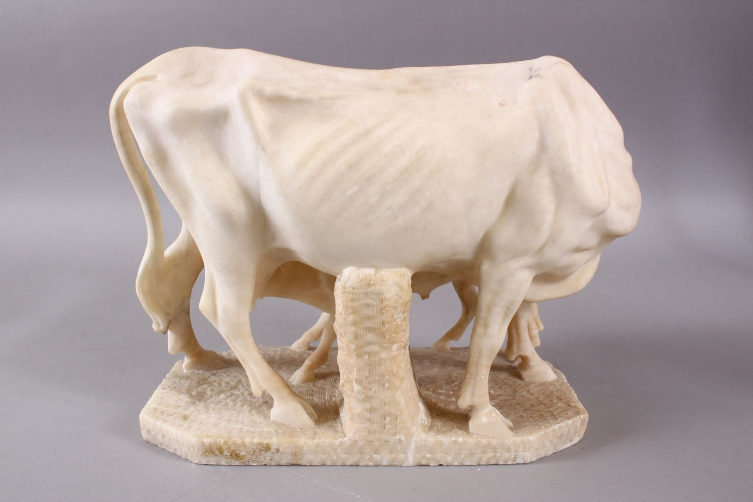 A 19TH CENTURY INDIAN ALABASTER MODEL OF NANDI COWS - the larger cow depicted with young, 25cm - Image 4 of 6