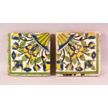 A PAIR OF 17TH/18TH CENTURY PERSIAN SAFAVID POTTERY TILES, each painted with floral sprays, 22cm