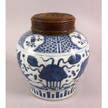 A CHINESE BLUE & WHITE PORCELAIN FISH GINGER JAR & COVER, decorated with fish and algae, with a