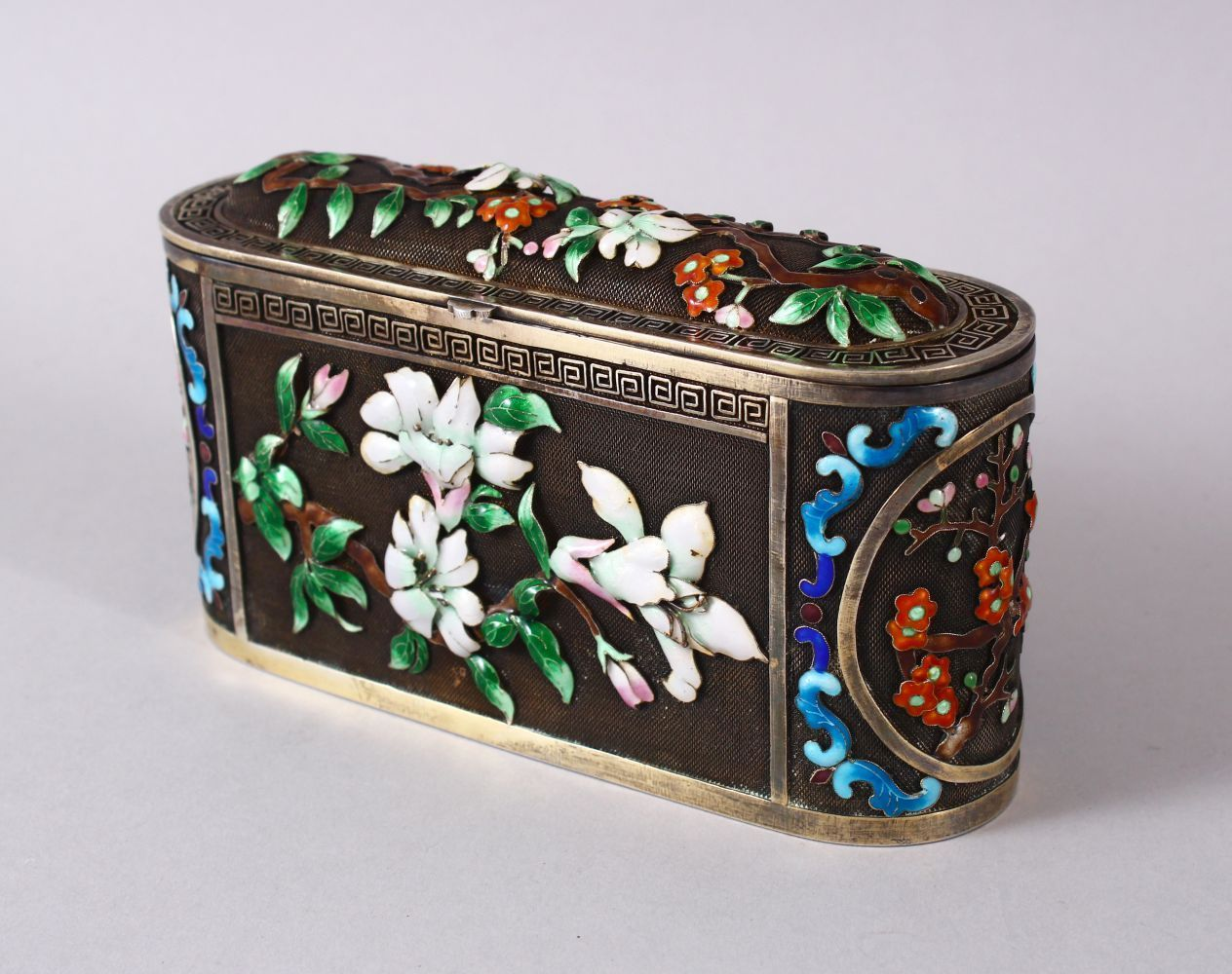 A CHINESE SILVER & ENAMEL LIDDED BOX, with enamel decoration of native flora, base marked silver,