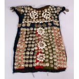 A 19TH CENTURY TURKISH SILVER ONLAID CHILDS DRESS, with silver roundel and shell applications.