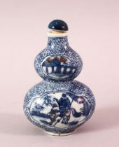 A CHINESE BLUE AND WHITE GOURD SHAPED PORCELAIN SNUFF BOTTLE, painted to each side with a figure