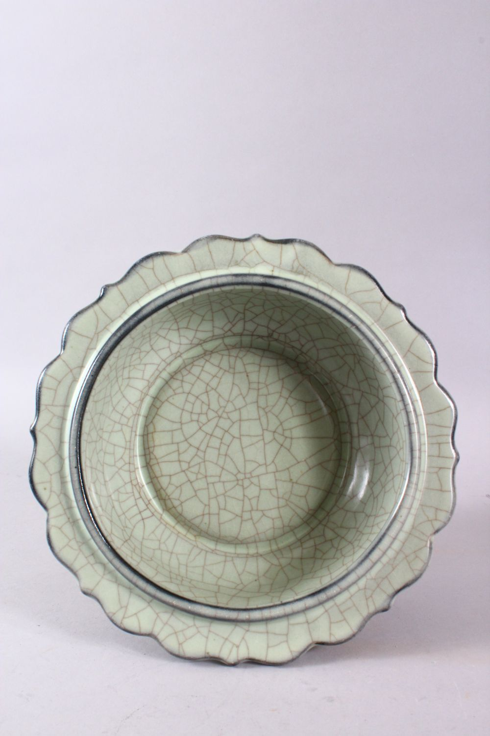 A CHINESE BARBED RIM GUAN GLAZED POTTERY DISH, the flared rim with ironwire style body decoration, - Image 2 of 3
