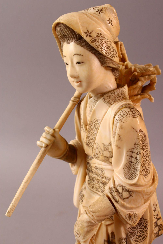 A LARGE JAPANESE MEIJI PERIOD CARVED IVORY OKIMONO - FARMER - the large okimono depicting a female - Image 7 of 11