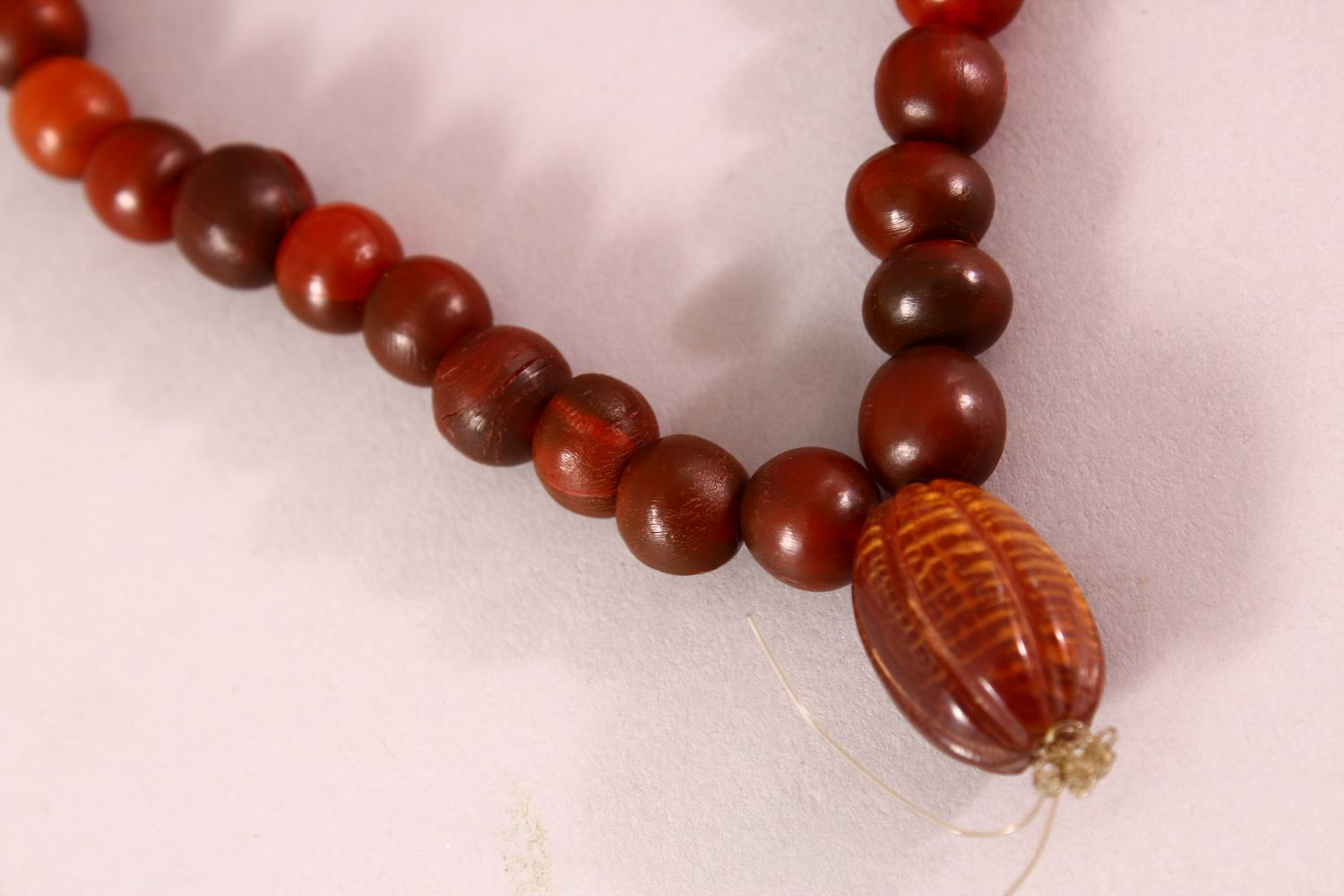 A RHINO HORN BEAD NECKLACE, beads approx 10mm diameter, weight 65g. - Image 3 of 3
