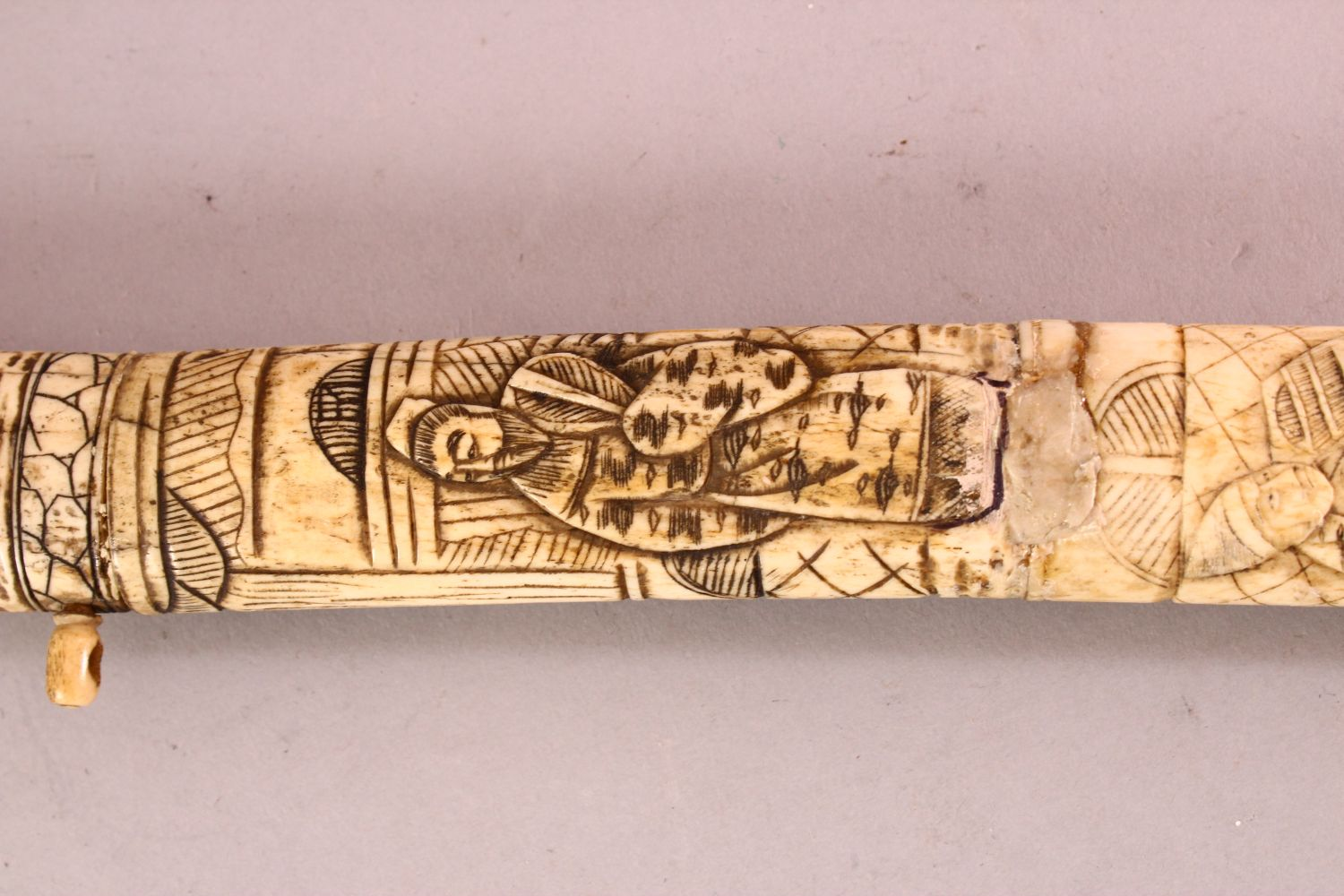 A JAPANESE MEIJI PERIOD SECTIONAL CARVED IVORY SWORD, carved with scenes of figures (AF) 85cm - Image 4 of 7