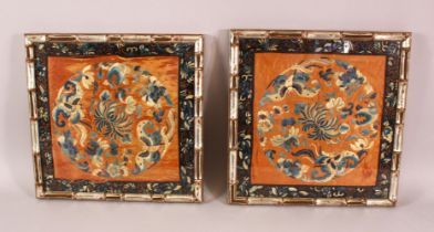 A PAIR OF 19TH CENTURY CHINESE EMBROIDERED SILK PANELS, with butterflies and flora, framed, 34cm